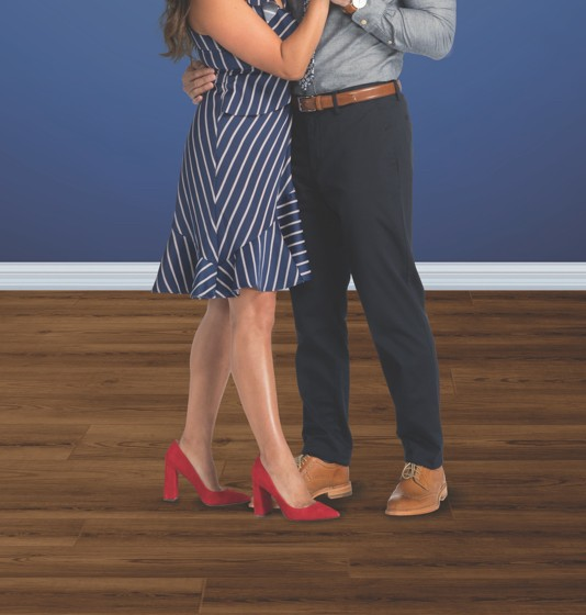 Couple dancing on flooring | Custom Floors