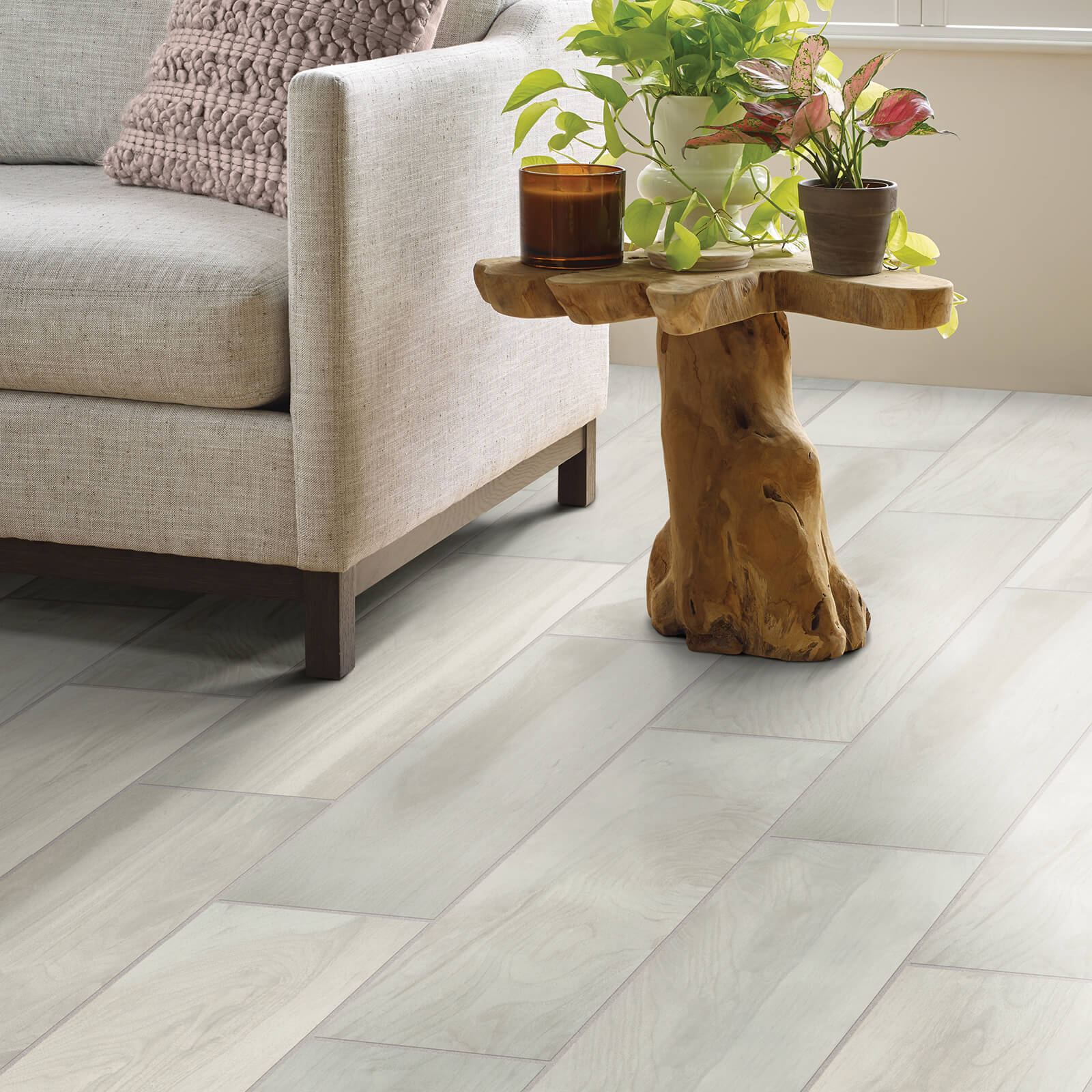 Tile in living room with accent chair | Custom Floors