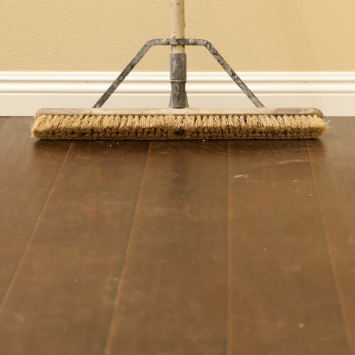 Sweeping hardwood flooring | Custom Floors