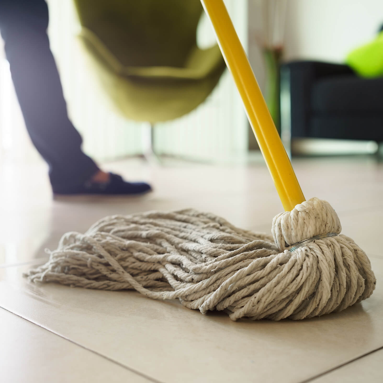 Mopping tile flooring | Custom Floors