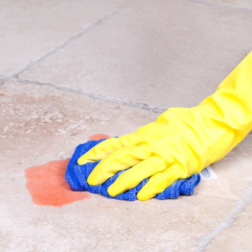 Cleaning spill on tile flooring | Custom Floors